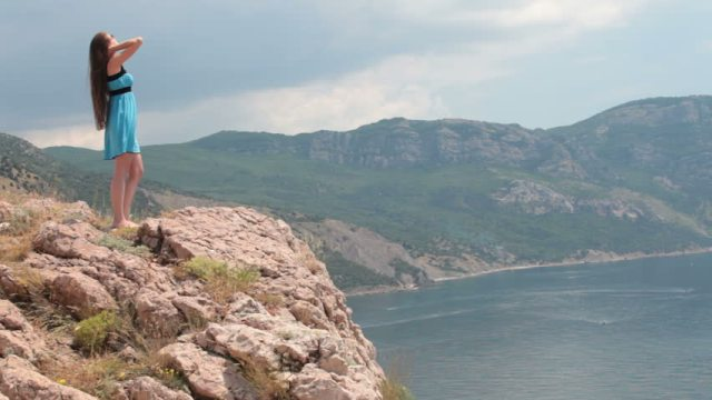 woman on cliff