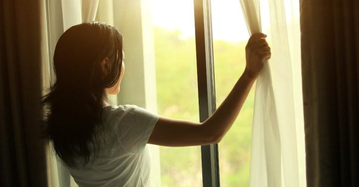 womanatwindow-window-curtain-morning.1200w.tn