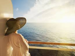 woman in hat on deck of ship
