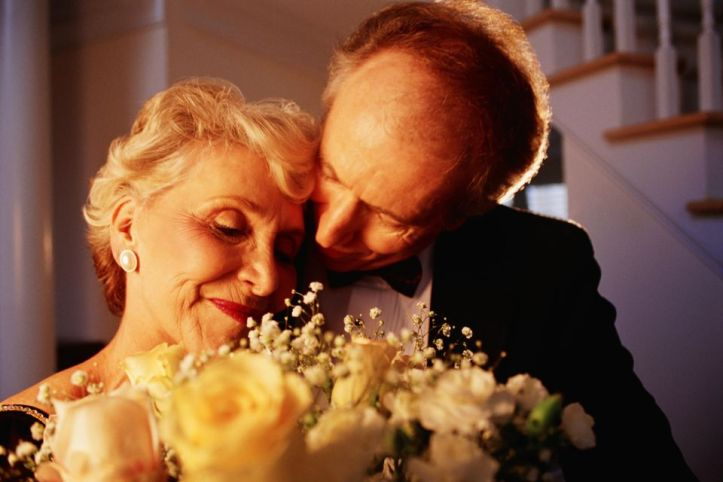 man giving wife flowers