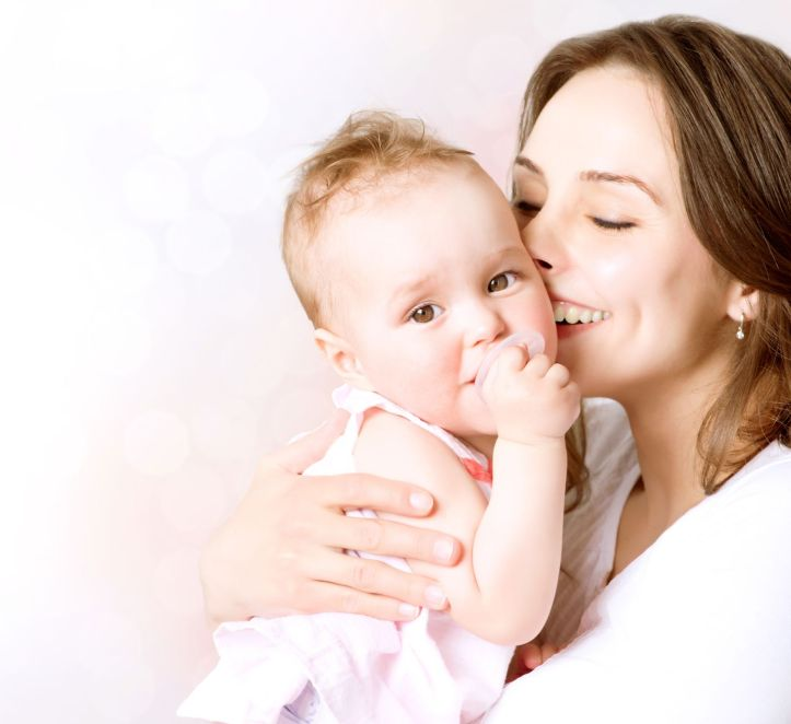 smiling mother and baby girl