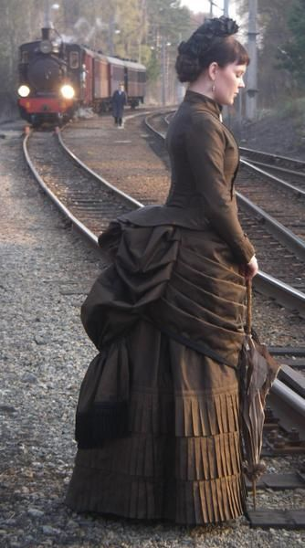 Victorian woman at train station