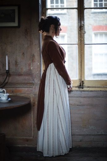 victorian woman looking out of the window