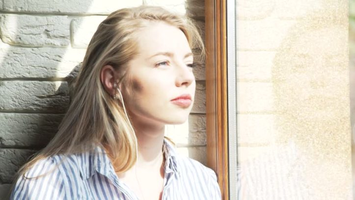 blonde woman looking out