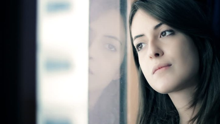 young woman pensive