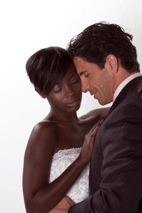 happy new wed interracial couple in wedding mood