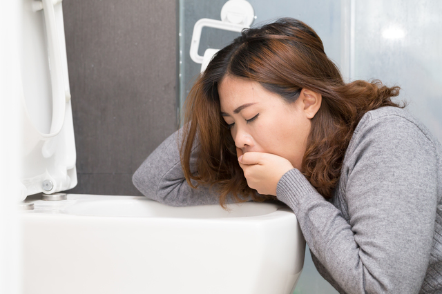 Asian woman have a morning sickness