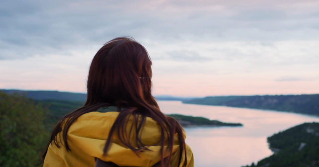 videoblocks-close-up-of-beautiful-young-woman-looking-up-at-sky-out-towards-horizon-view-on-top-of-mountain-enjoying-mindfulness-spiritual-moment-in-nature_rgmavahsx_thumbnail-full01