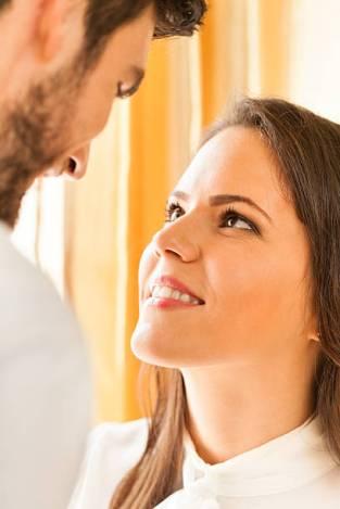 woman staring up at man