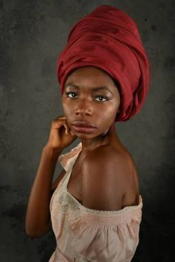 young-african-woman-with-red-turban-over-gray-background