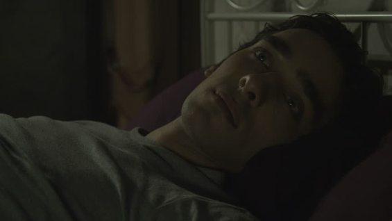 young man waking up at night