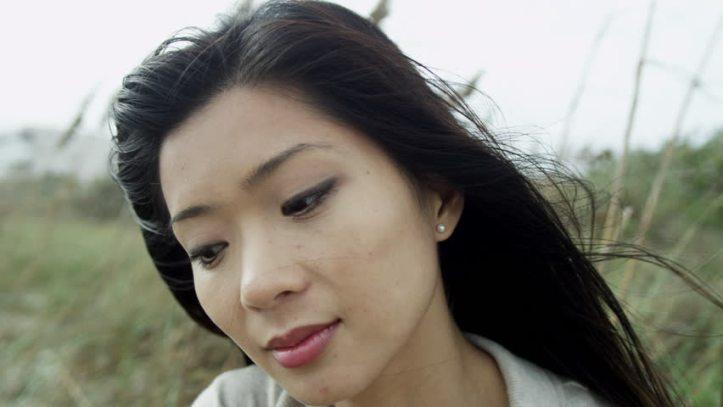 Pensive Asian woman2