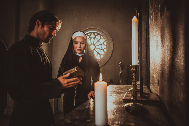 This image has an empty alt attribute; its file name is nun-priest-praying-spending-time-monastery_186382-3023.jpg
