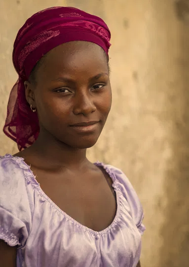This image has an empty alt attribute; its file name is young-african-woman.png