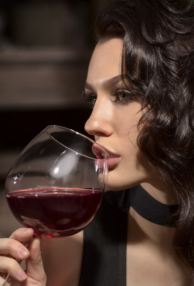 This image has an empty alt attribute; its file name is beautiful-young-girl-with-glass-wine_159160-488.jpg